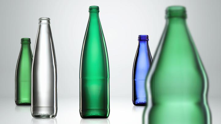 Empty glass bottles for mineral water and soft drinks